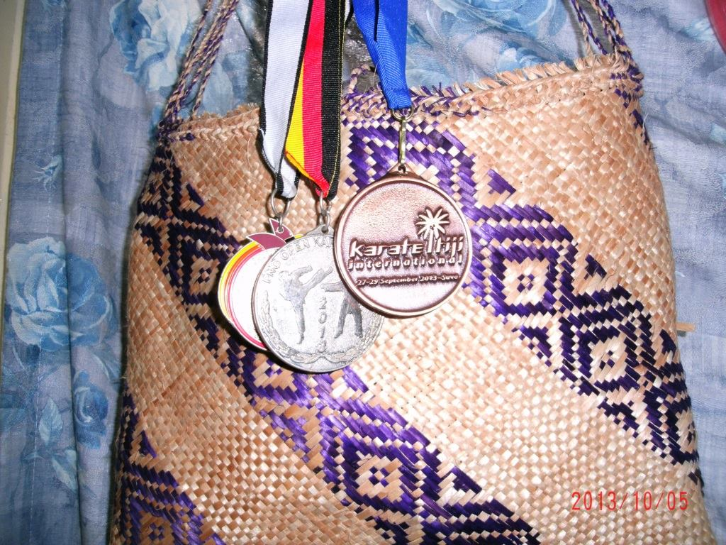 My silver medal from the 2013 PNG National Karate Championships and Bronze medal from the Fiji International that same year.